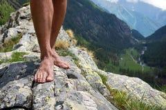 Barefooted on big stone mountains Stock Image