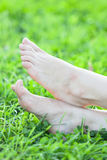 Barefooted female feet are on grass Royalty Free Stock Image