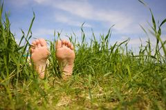 Barefooted a foot. In a years grass stock photo