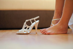 Barefooted foot of bride Stock Images
