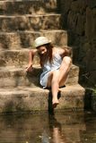 Barefooted girl. On the stairs Royalty Free Stock Photos