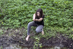 Barefooted girl in nature Royalty Free Stock Photography