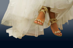 Barefooted legs of the bride. Wedding shoes on barefooted legs of the bride Royalty Free Stock Images