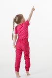 Barefooted little girl turning back and indicating something up Stock Image