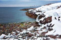 Barents Sea, Arctic. Beach with large round stones on the coast of the Barents Sea, Arctic Stock Photos