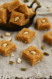 Barfi - indian sweet with coconut flakes, cardamom and cashew Stock Photo