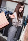 Bargain. Pretty woman makes bargain at shop Stock Photo