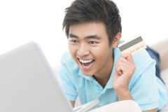Bargain. Excited guy making a bargain purchase online Royalty Free Stock Photo
