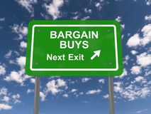 Bargain buys roadsign. A green bargain buys roadsign with the sky in the background stock photography