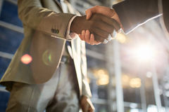 Bargain. Intercultural traders handshaking after making deal Stock Image
