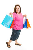 Bargain Shopper. Pretty plus sized woman excited about bargain shopping.  Full body isolatedo on white Royalty Free Stock Images