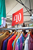 A bargain for a tenner. Second hand clothes rack at market. Portrait orientation Stock Images