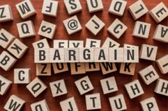 BARGAIN word concept. On cubes royalty free stock images