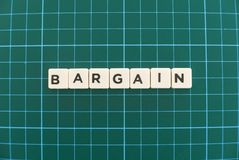 Bargain word made of square letter word on green square mat background. Price bargaining sale promotion store shop business agreement financial money corporate royalty free stock images