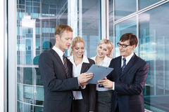 Bargaining. People in business suits are discussed Royalty Free Stock Images