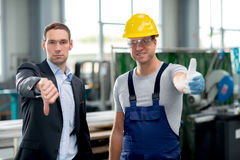 Bargaining. Collective bargaining- boss and worker with thumbs up and down Royalty Free Stock Image