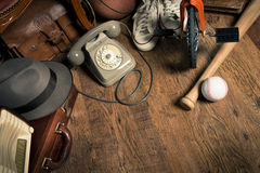 Bargains at flea market. Group of assorted vintage items on hardwood floor at flea market Royalty Free Stock Image