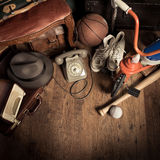 Bargains at flea market. Group of assorted vintage items on hardwood floor at flea market Stock Photos