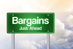 Bargains Just Ahead Green Road Sign Stock Photos