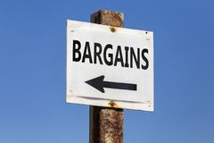 Bargains word and arrow signpost. On clear sky background. Motivational sign Royalty Free Stock Image