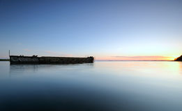 Barge. An old barge in a bay taken at sunset Stock Photo