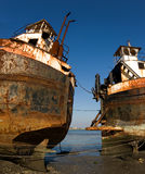 Barge. Two abandoned rusty river barges during low tide stock photography
