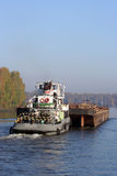 Barge. Pushed by towboat on the river. Copyspace is provided Stock Image