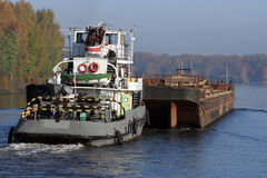 Barge. Pushed by towboat on the river Royalty Free Stock Photo