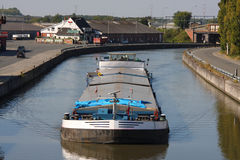 Barge. Advancing on a canal Stock Photography