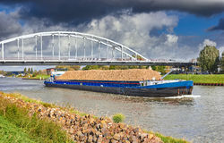Barge on the Amsterdam canal Royalty Free Stock Photo