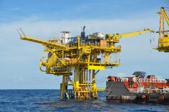 Barge And Tug Boat In Open Sea,Oil And Gas Platform In The Gulf Or The Sea, The World Energy, Offshore Oil And Rig Construction Stock Photos