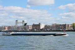 Barge on  backdrop of  waterfront of Rotterdam. Stock Image