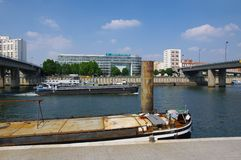 Barge in the bank of seine river Stock Photo