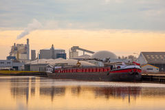 Barge Being Loaded at a Plant in The Netherlands. Inland Transportation Barge Unloading at a Chemical Plant stock photography