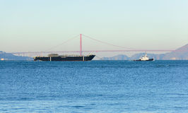 Barge being towed. San Francisco, CA - December 31, 2015: Sause Bros ship the Morro Bay being towed out of, San Francisco the morning of December 31, 2015 Royalty Free Stock Image