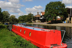 Barge on the Cam. Red barge moored on the River Cam in Cambridgeshire Royalty Free Stock Photography