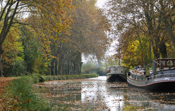Barge on canal Stock Image