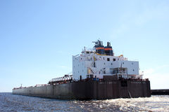 Barge in the canal - Duluth, MN. A view of a barge going through the canal in Duluth, MN Stock Image