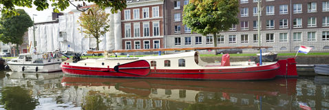 Barge in a canal Royalty Free Stock Images