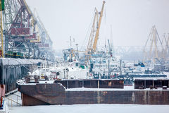 Barge in cargo port at winter Royalty Free Stock Photo