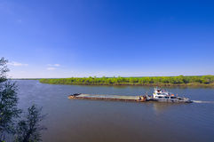 The barge with cargo on river in sunny day Royalty Free Stock Photo