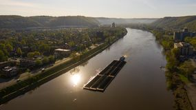 Barge Carries Coal Along Kanawha River and Charleston West Virgina. Charleston West Virgina ia an active seaport here a barge moves coal around royalty free stock image