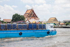 Barge carry soft drink drag by tug boat on Chaopraya river Royalty Free Stock Photography