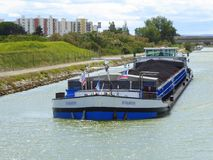 Coal carrying barge on French canal. A barge carrying coal on the Canal du Rhone a Sete in Provence, France stock images