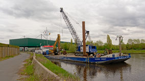Barge carrying cranes Royalty Free Stock Images