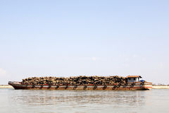 Barge Carrying Logs Stock Photo