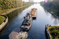 A barge in channel Stock Images