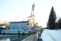 Barge with a crane. On the Moscow Canal stock images