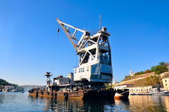 Barge with crane in a port Stock Image