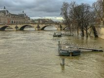 Barge docking stations on flooded Seine River in winter 2018, Paris, France. Winter 2018: Barge docking stations are not usable during the winter floods on the royalty free stock photo
